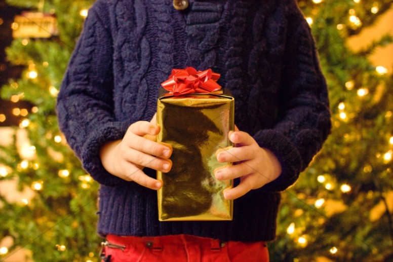 Child With Gift Christian Stock Images