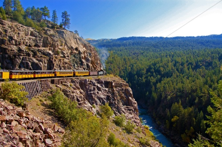 Train Climbing Mountain Side Religious Stock Photo