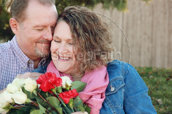Married Couple Valentines Day Hug with Flower Stock Photo
