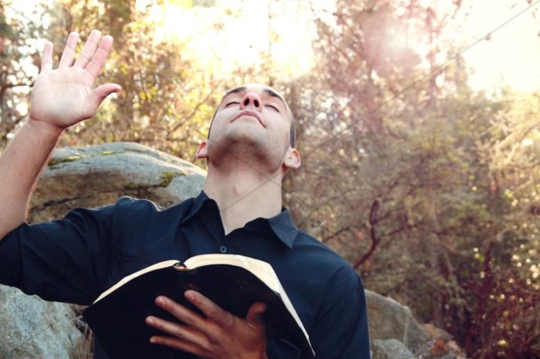 Man in Worship Christian Stock Photo