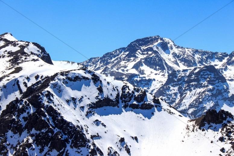Snow on the Mountain Peaks Religious Stock Photo