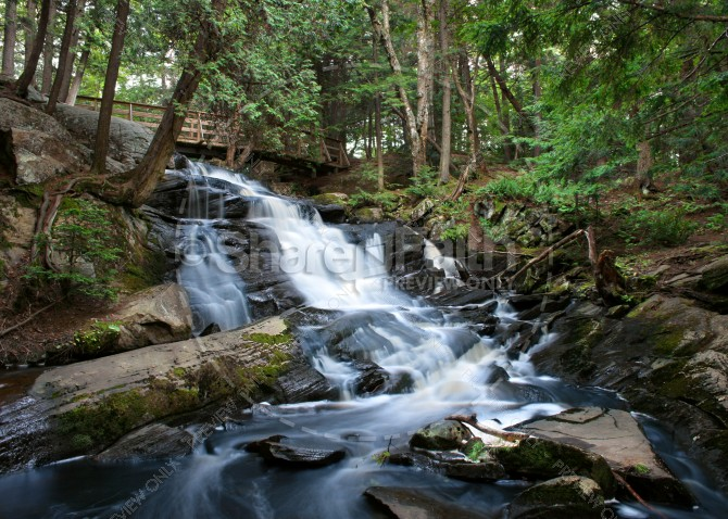 Waterfall Under the Bridge Ministry Stock Photo