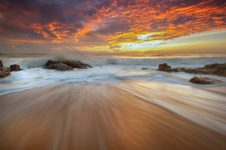 Ocean Waves at the Beach at Sunset Ministry Stock Photo