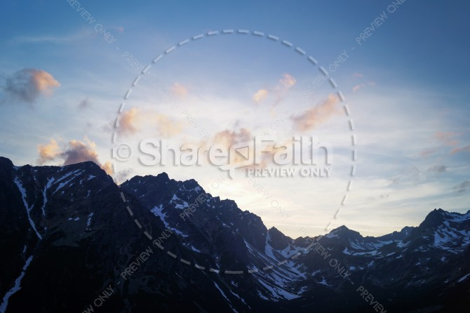 Light Peering Over the Mountains Ministry Stock Photo