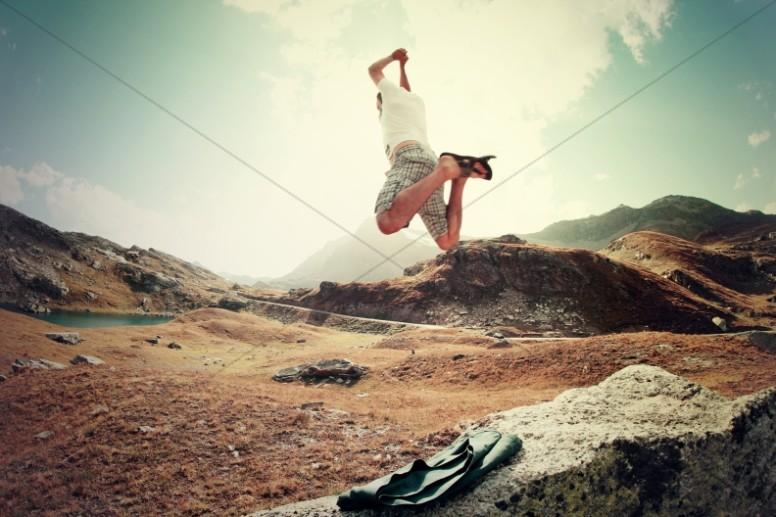 Man Jumping Religious Stock Photo