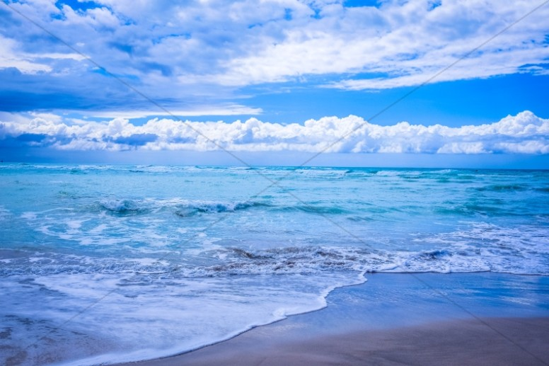 Blue Skies and Ocean Waves Religious Stock Photo