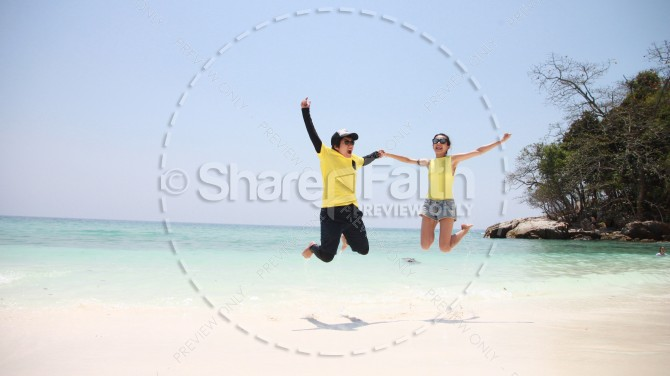 Summer Excitement Jumping on the Beach Stock Photo