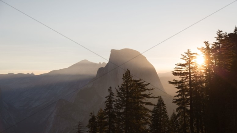 Sunrise Behind the Mountains Religious Stock Photo