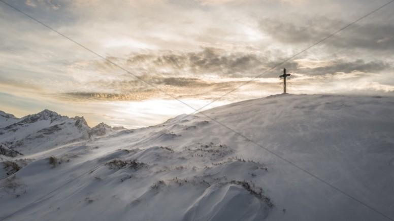 Cross on a Snowy Hill Christian Stock Photo