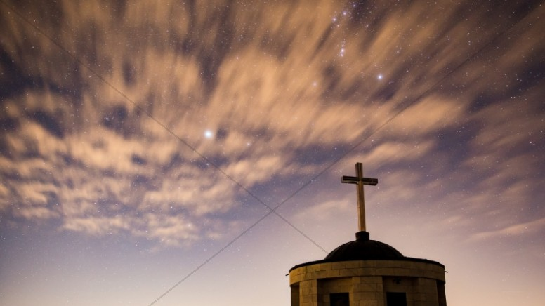 Clouds in the Sky Above Church with Cross Christian Stock Image