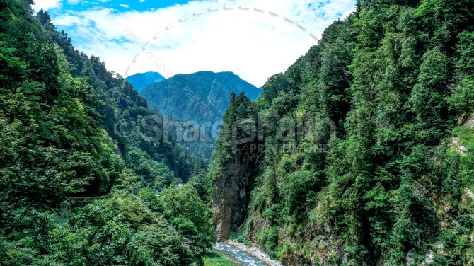 River Through Mountains Landscape Christian Stock Photo
