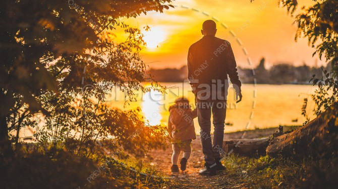 Father and Son Walking by the Lake at Sunset Christian Stock Image