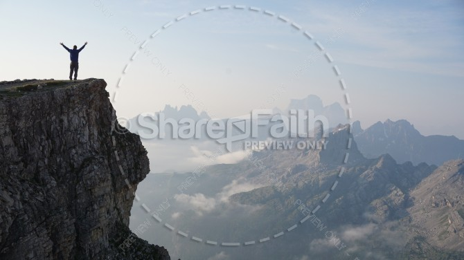 Man Worshiping From a Mountain Top Christian Stock Photo