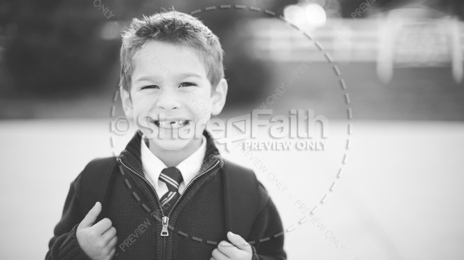 Smiling Boy With Backpack Religious Stock Photo