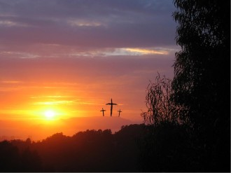 Three Crosses Against Glowing Sunset