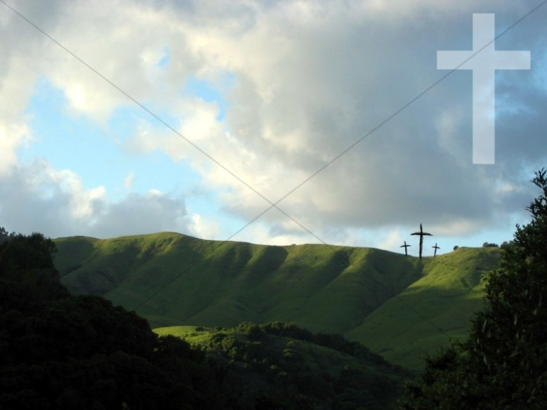 Three Crosses on Hillside