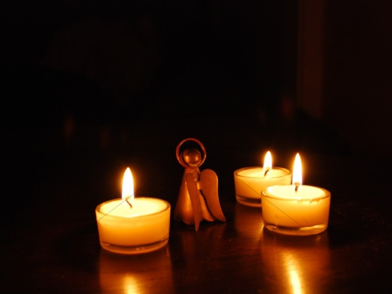 Angel in the Midst of Lit Candles