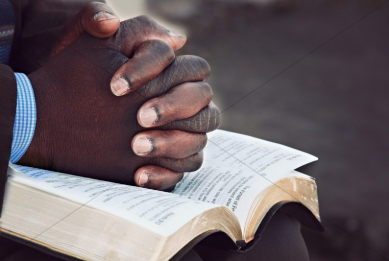 Hands of Prayer Christian Stock Image