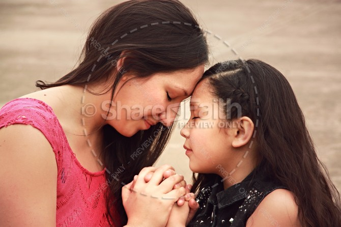 Mother and Daughter in Prayer Ministry Stock Photo