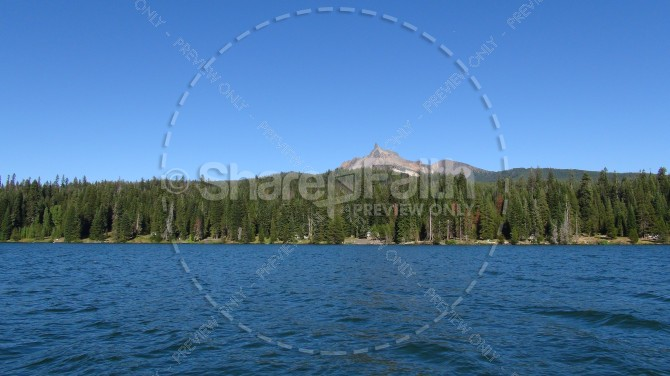 Shoreline of Trees and Mountain Views Stock Photo