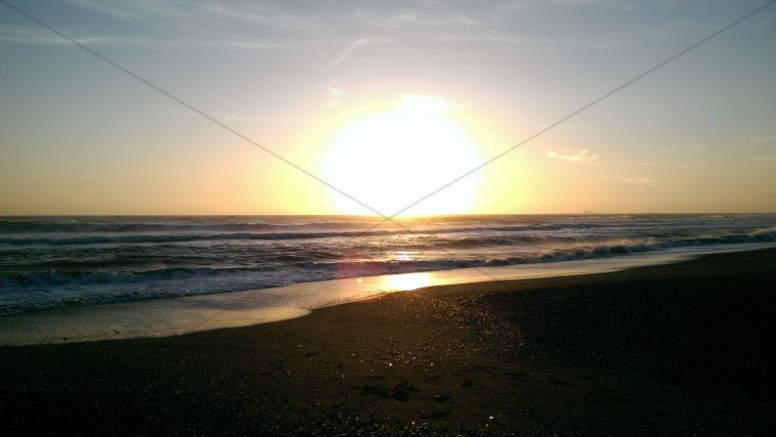 Setting Sun Over Beach Profile Ministry Stock Photo