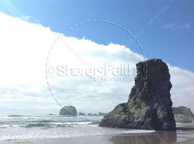 Large Rock on Beach Scene Religious Stock Photo