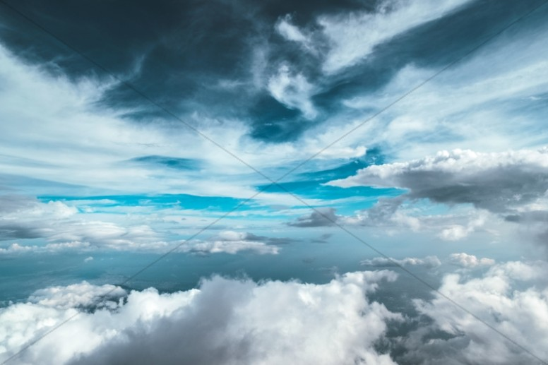 Flying Through the Clouds Religious Stock Photo