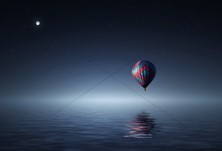 Hot Air Balloon Over the Ocean Religious Stock Photo