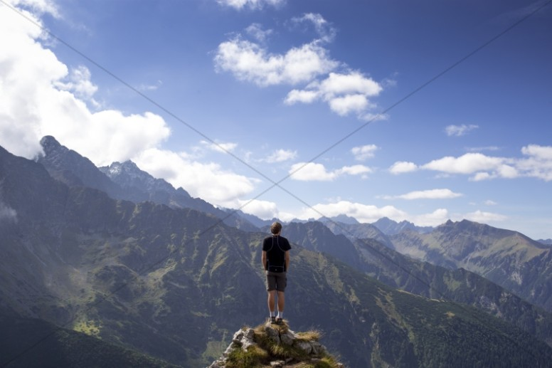 Man on a Mountain Ministry Stock Photo