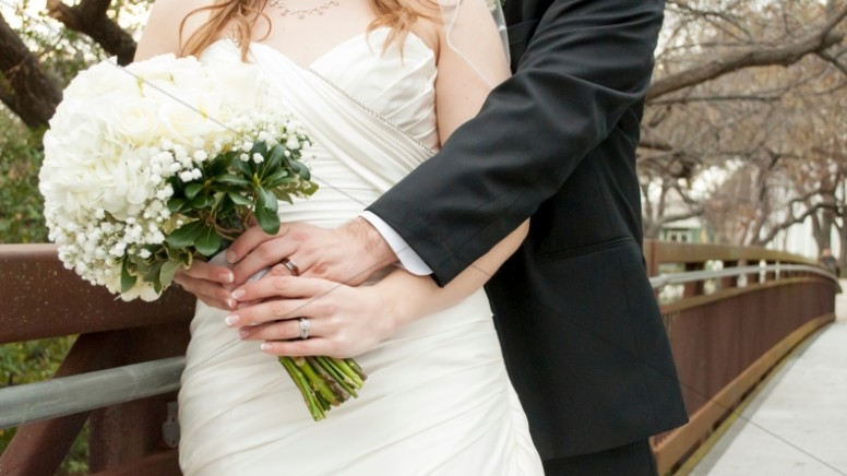 Bride and Groom Embracing Religious Stock Photo