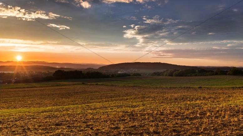 Sunset Over the Plains Christian Stock Photo