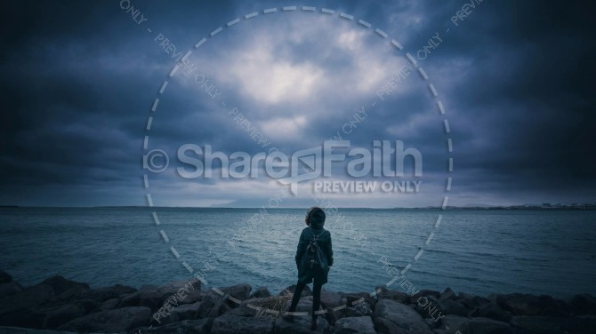 Youth out in Stormy Weather at the Beach Christian Stock Photo