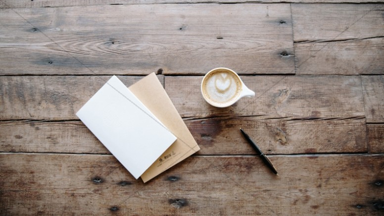 Coffee and Notebook on a Wooden Table Church Stock Photo