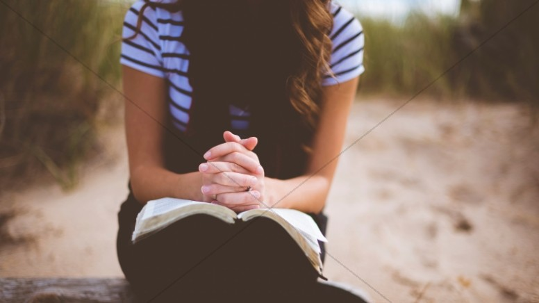 Girl Praying With Bible Religious Stock Photo