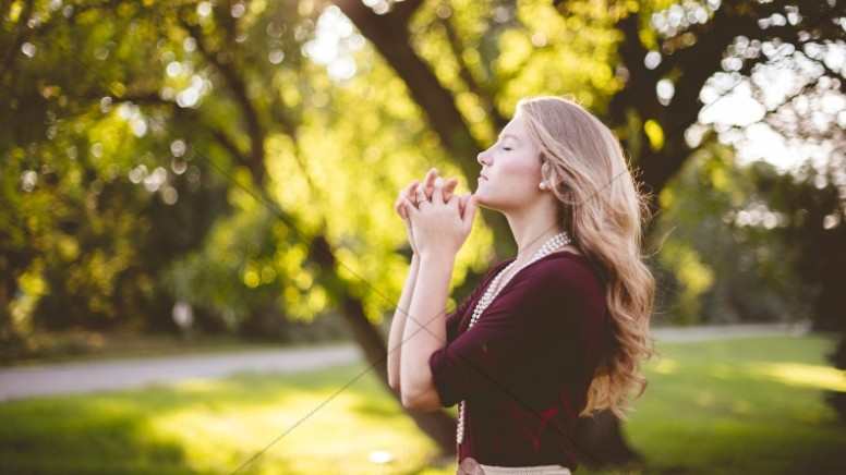 Woman Praying Outside Christian Stock Photo
