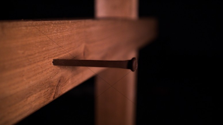 Nail In A Cross Christian Stock Photo